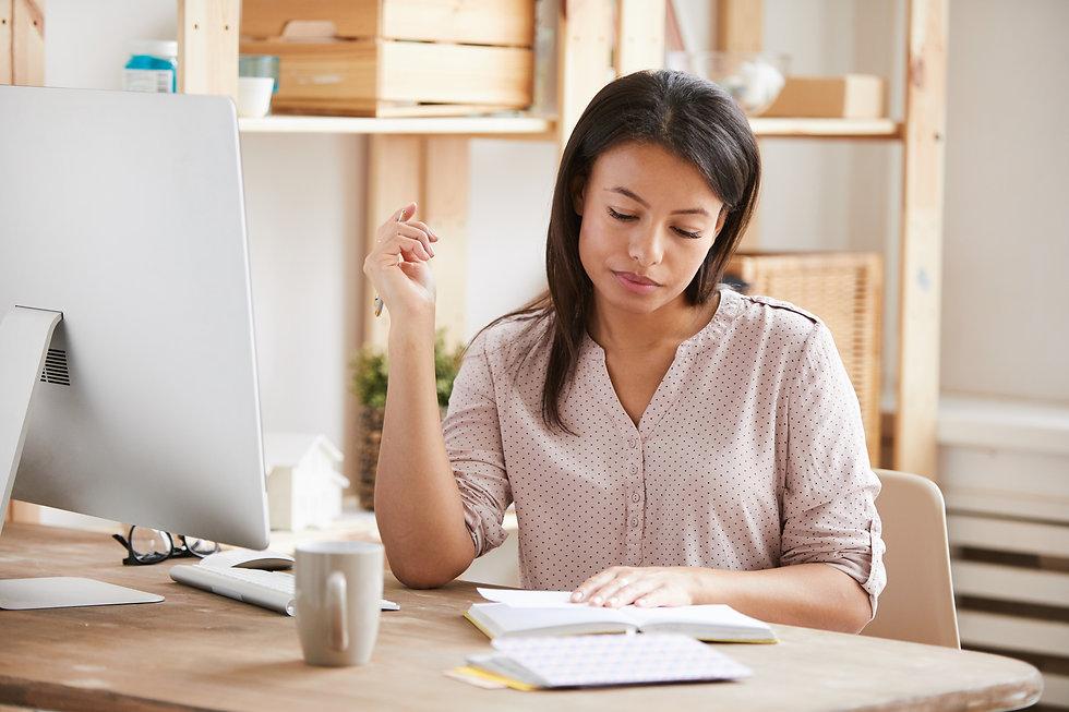 beautiful-woman-writing-at-desk-JMGY4QF.