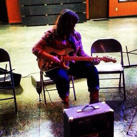 Donna Scott works on her chords at the first Lady Rockstars class in Cube NoDa