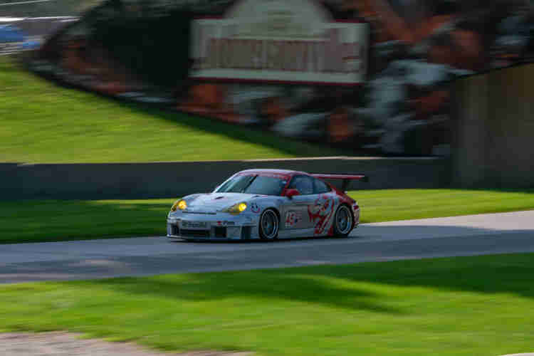 """A """"Flying Lizard"""" in the shadows entering the """"Carousel"""" Loren Beggs 2004 Porsche 911 RSR weathertech international challenge with brian redman at road america elkhart lake wisconsin"""