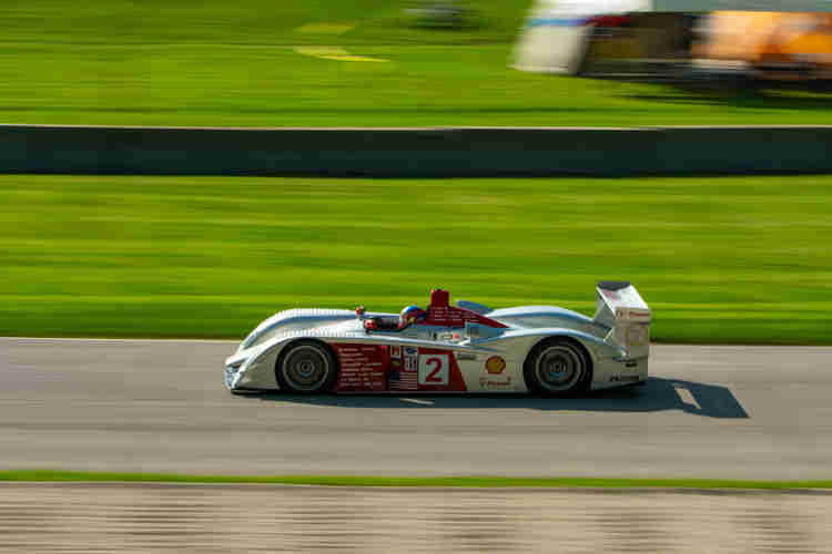2005 Audi R8 LMP being handled by Travis Engen around the Carousel weathertech international challenge with brian redman at road america elkhart lake wisconsin