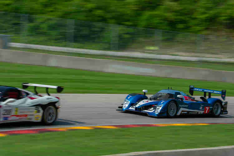 David Porter creeping up quickly in his 2007 Peugeot 908 HDi Masters Endurance Legend. ferrari 485 challenge weathertech international challenge with brian redman at road america elkhart lake wisconsin