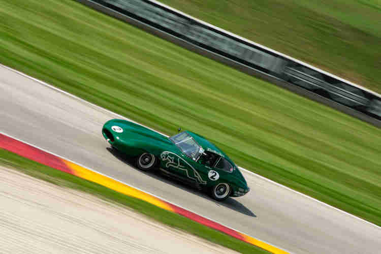 Phillip Taxman in this 1964 Jaguar XKE Coupe weathertech international challenge with brian redman at road america elkhart lake wisconsin