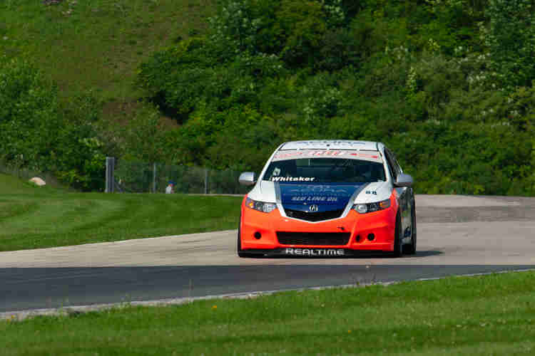 John Whitaker getting on the brakes hard for turn 14 in his Realtime Racing 2009 Acura TSX weathertech international challenge with brian redman at road america elkhart lake wisconsin