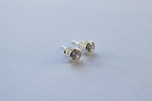 Circular CZ Rub Over Set Stud Earrings