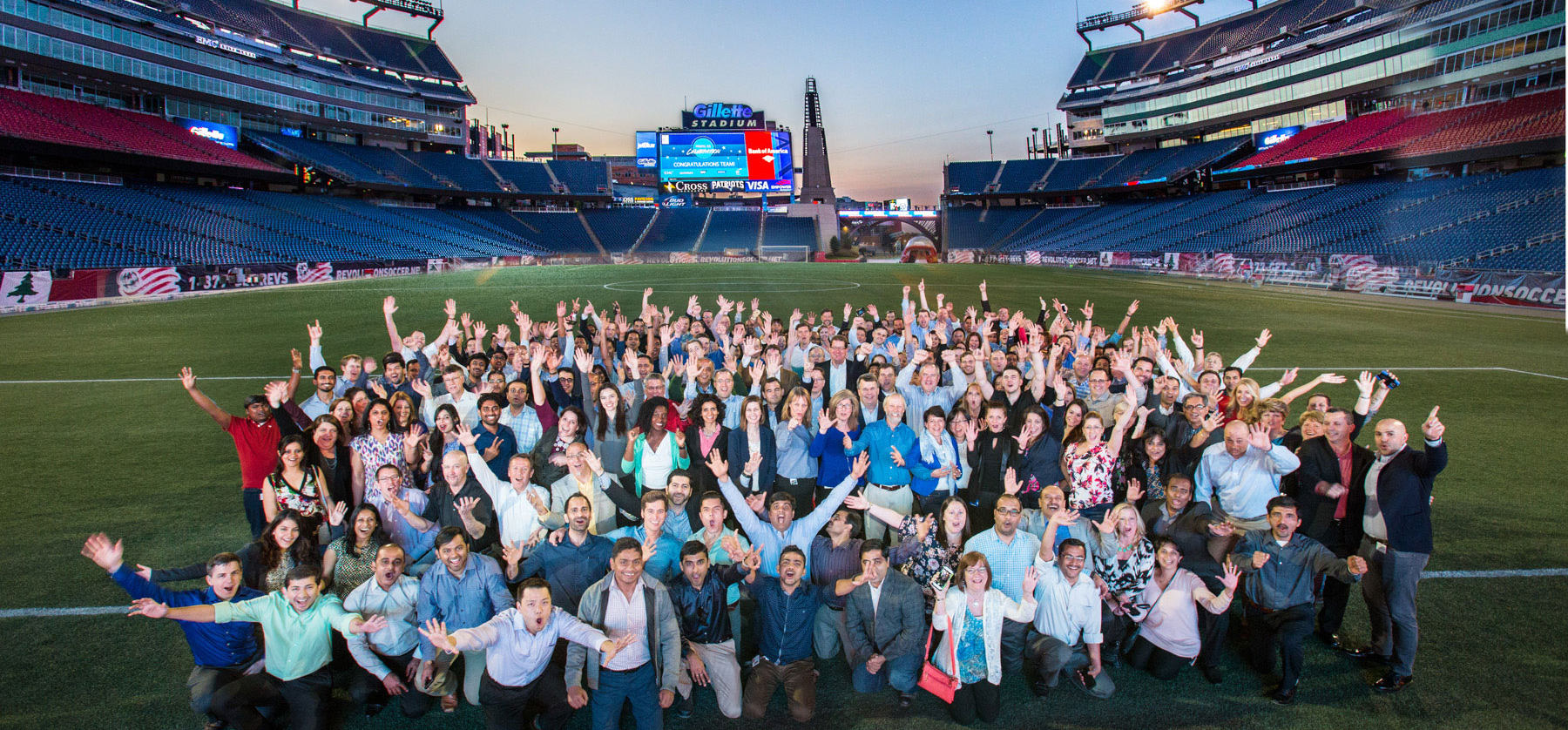 EMC group portrait on field-Gillette Stadium Field