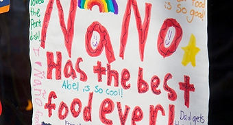 """Picture of a child's drawing that reads """"ñaño has the best food ever"""""""