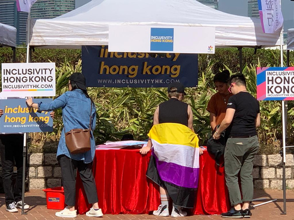 Volunteers interacting with guests at HKPride Booth