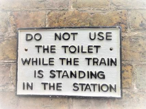 Do Not Use Toilet While Standing Train Is Standing Sign