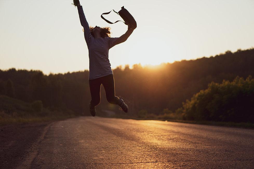 woman-jumped-on-gray-asphalt-road-129680
