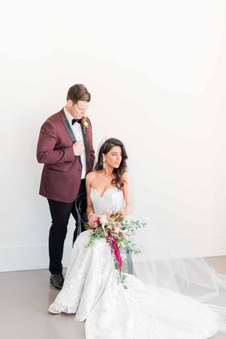 Bride & groom in burgundy, new orleans, the jax