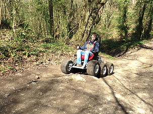 A disabled user rides a HexHog in the woods