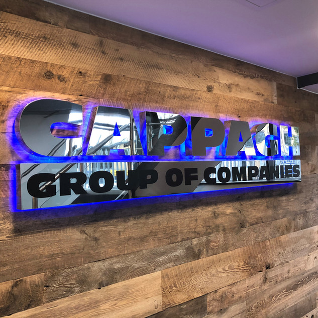 Back-lit corporate metal sign
