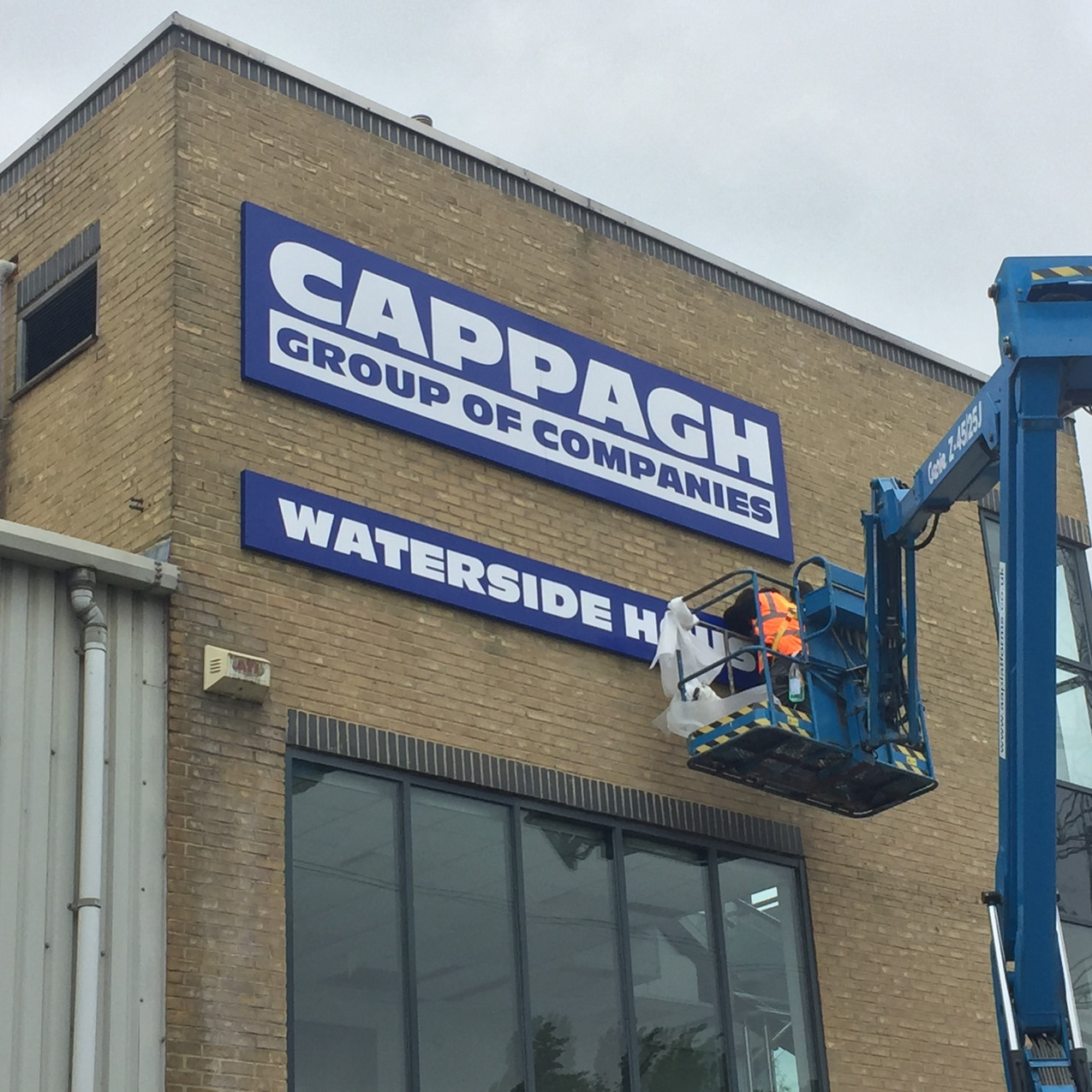 High level tray sign installation