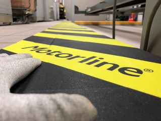 Safety stripe solution for MOT bays.