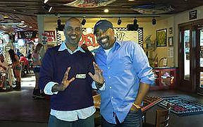 Sonu performing magic for Darius Ruckr of Hootie and the Blowfish