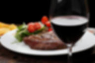 84115160-rib-fillet-with-salad-red-wine.
