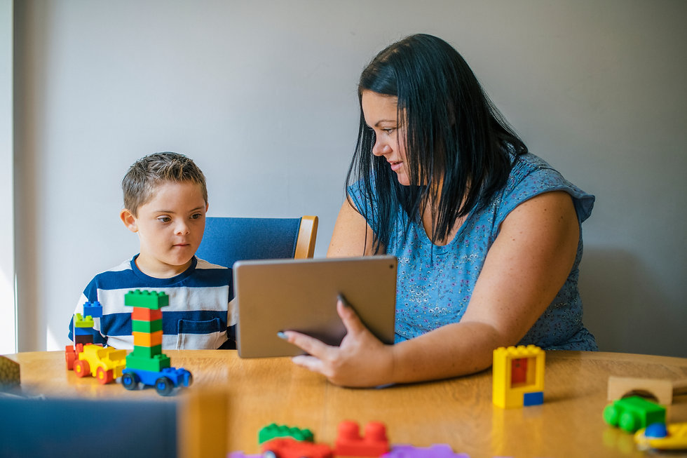 Mother teaching son from a tablet.jpg