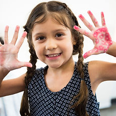 young-girl-showing-hands-color-stamp-PXQ