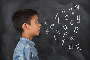 kid with letters.jpg