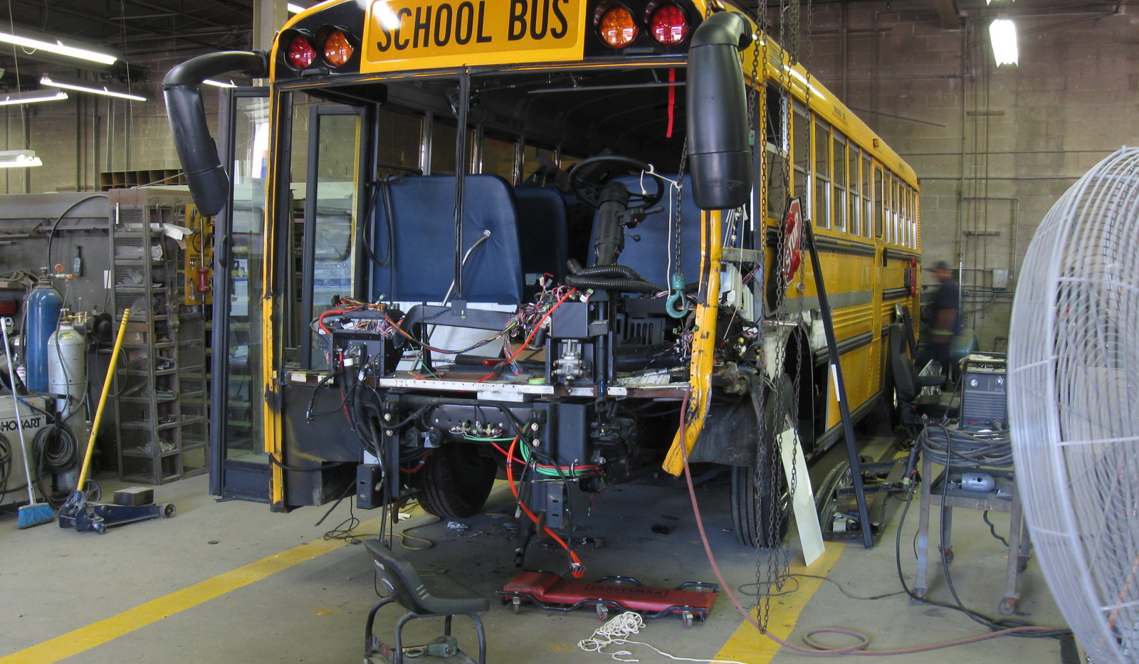 Bus Repair in Shop.JPG
