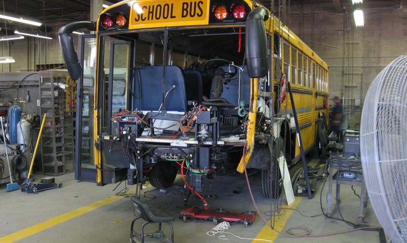 Bus Repair in Shop.JPG