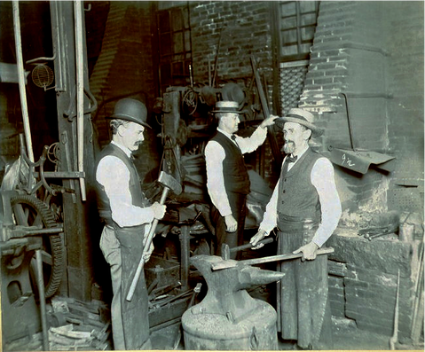 Herman and crew working in the shop