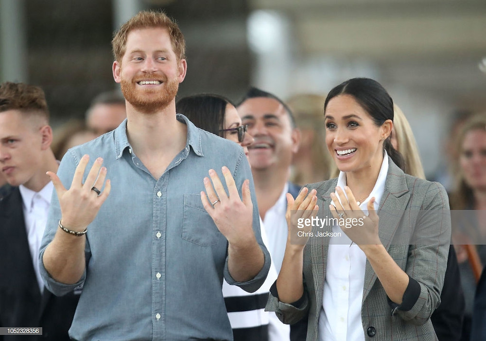 Prince Harry, wearing an Oura ring, with Meghan Markle | Getty Images