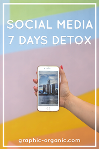 Social Media 7 Days Detox: Hand holding white IPhone in front of colourful wall