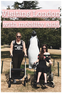 Visiting London With Mobility Aids: Kirsten and Beth in Regent's Park in London posing in front of penguin statue. Kirsten is using a walker. Beth is sitting in her electric wheelchair.