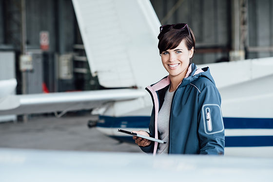 Smiling female pilot connecting with a d