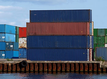 Image of cargo containers stacked on port