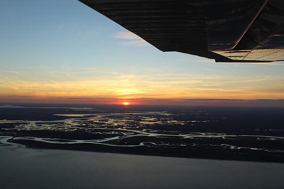 The sun sets over the Florida coast as s