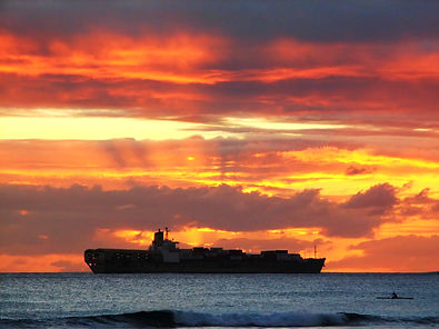 photo of cargo ship at sunrise