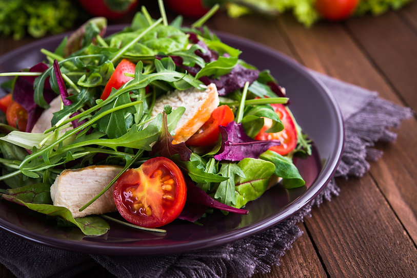 Fresh salad with chicken, tomatoes and m
