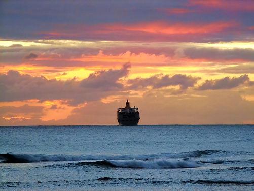 Photo of cargo ship at sunrise
