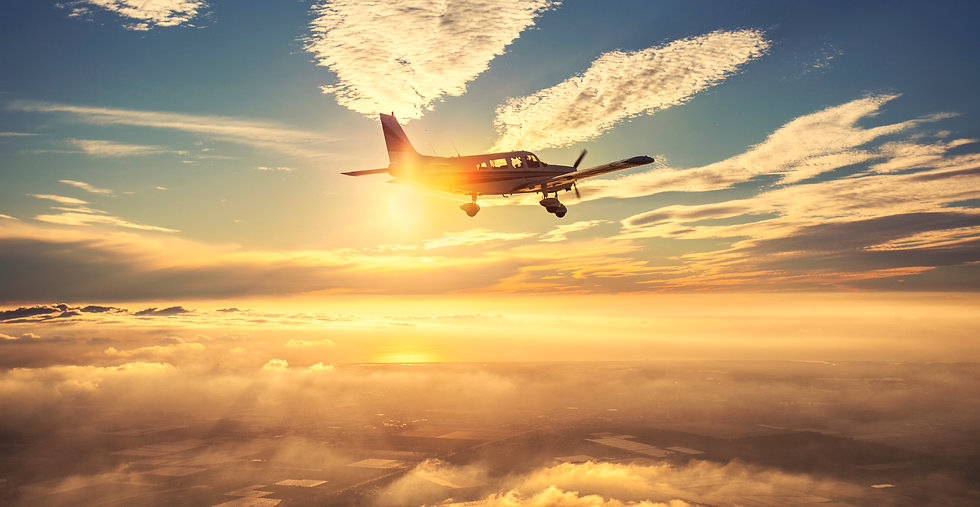 Small single engine airplane flying in t