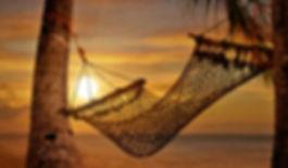 hammock on the beach at sunset