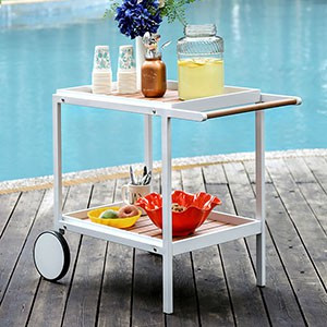 send the party outside with this handy serving cart the sleek white finish off ers a modern framework and slatted panels line the two shelf tiers