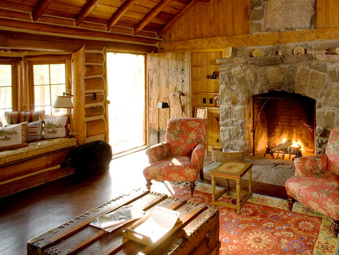 Log home living room fireplace