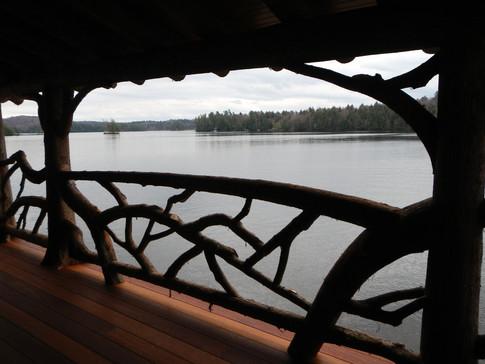 Adirondack porch log railing