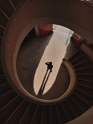 person-standing-below-a-spiral-staircase