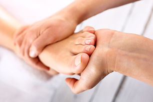 Foot massage in the spa salon.Woman in a