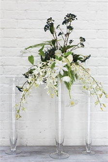 Floral Arrangement on Glass Riser