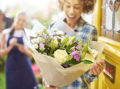 stock Image, Woman receiving flowers, flower delivery