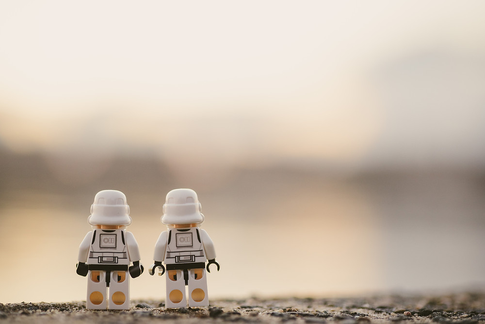 Two Lego Star Wars Clone Storm Troopers enjoying the sunset looking out over the water.