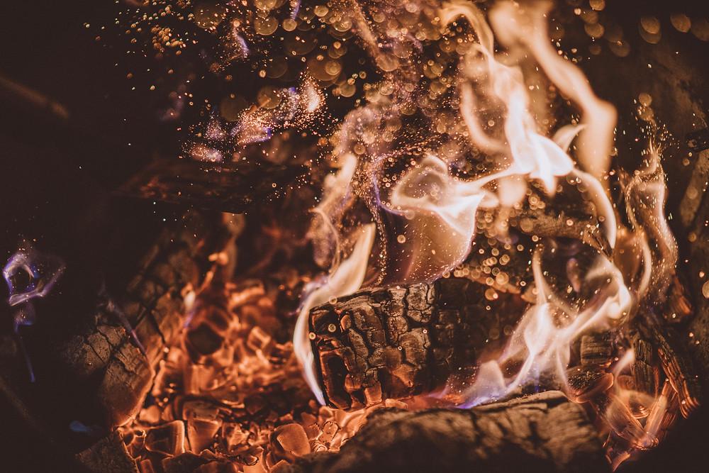 Flaming and charred wood