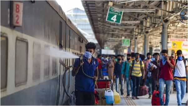 Railway workers spray disinfectants to mitigate the coronavirus pandemic at MGR Central Railway Station, in Chennai. (PTI)