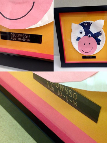Shadow box of childs paper art