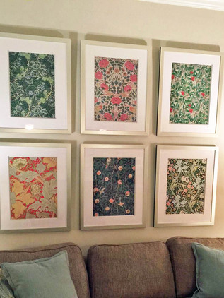 Custom framed William Morris prints hung in a grid in customers home.