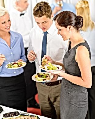 Business colleagues eat buffet appetizer